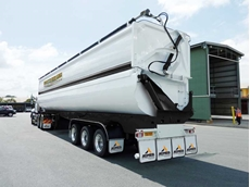 AZMEB's HVST (High Volume Side Tipper) is a side tipping trailer with a lower tub complemented by a hinged upper body