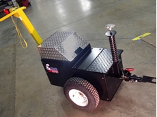 The Load Mover electric tug assists production personnel in moving heavy carts