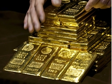 Gold production rises, price slide remains