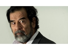 Note Printing Australia allegedly had secret dealings with Saddam Hussein