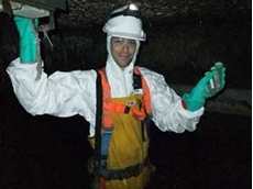 Dr Barry Cayford, who completed his PhD at UQ, at work on sewer research