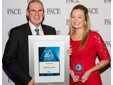 SICK's strategic industry manager, mining, Graham Robson with Zenith Young Achiever Michaela Craft from BOC Gases.