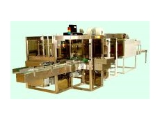 Automatic tray packer and shrink wrapper.