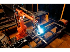 The ABB IRB 2400L robot system in action in the arc welding station with the L type part positioner
