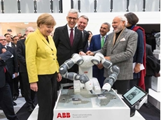 German Chancellor Angela Merkel and Indian Prime Minister Narendra Modi meet YuMi at Hannover Messe