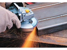Angle grinder in action with flap disc