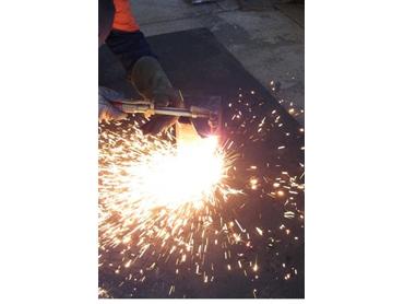 Telfon coated matting for machinist and welders