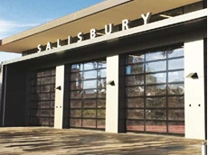 AAES brand Crawford's fully-glazed overhead sectional doors were installed at the fire station's four-bay appliance room