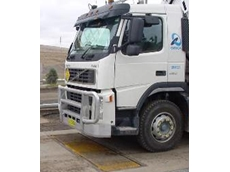 In-motion truck scales weigh individual axles