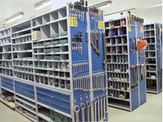 A perforated panel can be installed to the end of each shelf to provide extra space for holding tools, keys or other items
