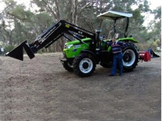 Marcus with his Agrison 75hp FEL and rotary hoe attachment