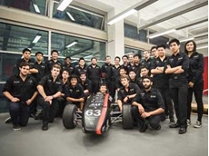 UNSW Redback Racing Team with their formula racing car featuring a monocoque chassis designed using composite panels routed by Allplastics