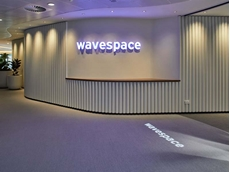 Curved Plexiglass blades create floor to ceiling partition at EY WaveSpace