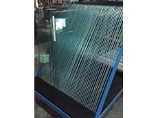 Allplastics offers custom black, high density polyethylene panels with CNC routed grooves for safe glass handling