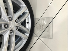 Protecting car showroom floors from tyre markings with polycarbonate pads