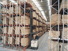 The racking and pallets are designed to lock together so the pallets can't move or fall out even when a forklift bumps into the racking