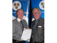 John Nickless receiving the 25 years of membership award