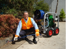 Aussie Pumps' Bruce Hulm with the new diesel powered 5,000 psi King Cobra drain cleaner