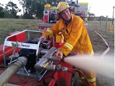1st Lieutenant Dallas Campbell of Dumbalk Fire Brigade demonstrates the enormous pressure of the Aussie Sea Skipper fire pump.