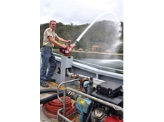 Michael Milligan shows off the power of the Aussie GMP pump for fire fighting