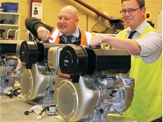 Aussie's Brad Farrugia and Craig Bridgement check a big production run of Kubota powered Aussie water transfer pumps.