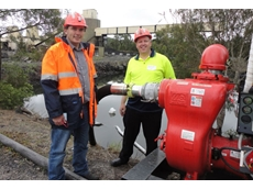 Centennial Coal's Morgan Gleeson, Graduate Environment Specialist and Aussie Pumps Dean Fountain inspect the Aussie trash pump on site