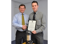 Aussie Pumps Product Manager Craig Bridgement accepts award