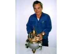Australian Pump Industries' John Logan with a repaired Metrex Thermostatic Regulating Valve.