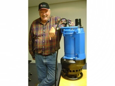 Tsurumi Pump's Bill Davidson inspects a dewatering pump designed for the mining industry