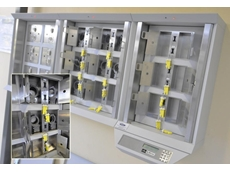KeyWatcher hybrid system with a master cabinet (R) and two slave cabinets used to control restricted assets (handcuffs). Inset is a close-up of the cabinet with handcuffs