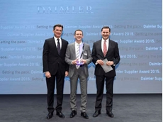 Albrecht Luick, Axalta Business Director-EMEA (centre) with Dr Wolfgang Bernhard (L) and Dr Marcus Schoenenberg from Daimler