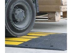 Traffic calming rubber speed humps have a yellow anti-slip insert