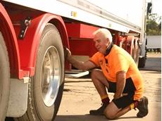 Mr Bearman inspects a trailer tyre