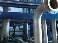 Induction bending is preferred because the use of bends in place of elbows reduces labour costs in plant piping construction