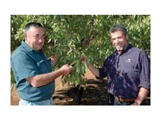 Red Cliffs almond grower, Barry Hensgen, and BioAg Horticulturalist, Marco Retamoza