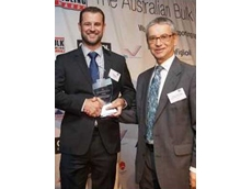 Matt Ryan, Bonfiglioli National Sales Manager (left), accepts the award from Bulk Materials Handling's Peter Delbridge