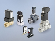 Solenoid valves showing various material options; clockwise from left: types 6213, 0124, 0142, 5282, 6144, 6650
