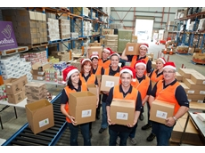 Resplendent in Santa hats, the CHEP team packed more than 500 Christmas hampers for Foodbank