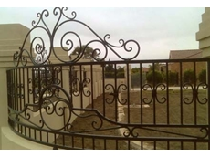 A wrought iron fence railing