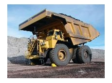 The Caterpillar 793 Haul Truck (240 ton) chocked using two model 1911 Monster wheel chocks