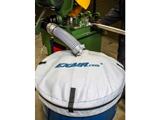 Fine mesh drum cover keeping bulk material contained and contaminant-free