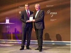 Ken Dufford, Vice President Europe at Crown, accepts the IFOY 2014 Award in the 'Warehouse Trucks' category