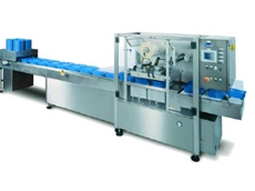 DFC's D900 high speed, fully automatic in-line film and dome heat sealing machine