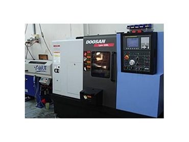 Datco Industries' Doosan CNC Lathe precisely machines plastics to your specifications