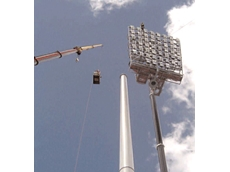 The Chubb Fire and Safety team uses a 160-tonne crane to lift one of four 11m lighting head-frames into place
