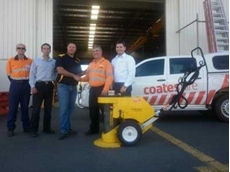 Warren Baltineshter, Enerpac Mining Manager – Australia & New Zealand (third from left)  and Phil Gage (Coates Hire Product Specialist – Lift & Shift) (second from right)