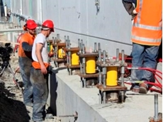 Twenty-two 100 ton and 150 ton Enerpac 700 bar cylinders were installed on steel stools and connected to the building's foundation
