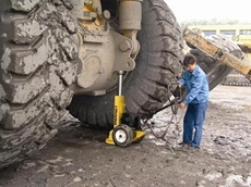 Enerpac lifting equipment in use to lift a heavy tractor for maintenance