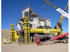 shows Enerpac lifting apparatus employing laser positioning sensors