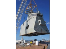 Hoisting operating control tower sections of the 28,000 tonne Landing Helicopter Deck vessels being built by BAE Systems Australia